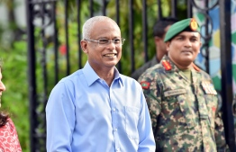 President Ibrahim Mohamed Solih watching the Maldives National Defence Force parade. PHOTO: HUSSAIN WAHEED/MIHAARU.