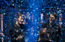 "Emil ""Nyhrox"" Bergquist Pedersen (L) and Thomas ""Aqua"" Arnould pose with their trophies after winning the Duos competition during the 2019 Fortnite World Cup Finals - Round Two, on July 27, 2019, at Arthur Ashe Stadium, in New York City. (Photo by Johannes EISELE / AFP)"