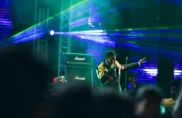 Meynaa Hassaan in his element - pumping up a crowd on a big stage, eclipsed by lights and nostalgia. PHOTO: HUSSAIN WAHEED/ MIHAARU