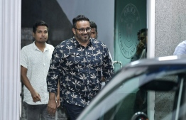 Former vice president Ahmed Adeeb pictured exiting the Maldives Police Service headquarters following his extradition. PHOTO: NISHAN ALI / MIHAARU
