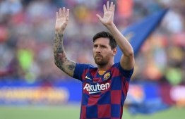 Barcelona's Argentinian forward Lionel Messi waves before the 54th Joan Gamper Trophy friendly football match between Barcelona and Arsenal at the Camp Nou stadium in Barcelona on August 4, 2019. PHOTO: JOSEP LAGO / AFP