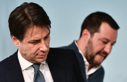 In this file photograph taken on January 14, 2019, Italy's Prime Minister Giuseppe Conte (L) and Italy's Interior Minister and deputy PM Matteo Salvini attend a press conference at Palazzo Chigi in Rome. Matteo Salvini's summer 'Beach Tour', billed as a chance to woo voters with a view to possibly forcing early elections, got off to a bad start on August 7, 2019, as Italy's populist government wobbled. PHOTO: VINCENZO PINTO / AFP
