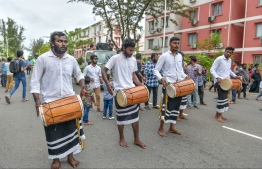 It is not an Eid parade unless accompanied with traditional 'Boduberu' music. Spectators join in on the songs, singing and dancing to their heart's content. PHOTO: NISHAN ALI/ MIHAARU