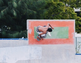 A youth skating over the Maldivian flag in Hulhumale' Skate Park, donned in traditional Maldivian attire. The well-receieved event organised by Skateboarding Association of Maldives aimed to play a modern sport in traditional attire. PHOTO: IYAD IBRAHIM