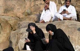 Smartphones are rapidly replacing traditional printed holy books as a means to read Koranic verses. PHOTO: AFP