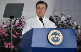 "South Korean President Moon Jae-in delivers a speech during a ceremony to mark the 74th anniversary of Korea's liberation from Japan's 1910-45 rule, at the Independence Hall of Korea in Cheonan on August 15, 2019. - South Korean President Moon Jae-in struck a conciliatory tone towards Japan on August 15, offering to ""join hands"" if Tokyo chooses dialogue as relations between the two dip to fresh lows. (Photo by Jung Yeon-je / POOL / AFP)"