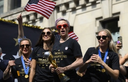 "(FILES) In this file photo taken on July 10, 2019 Megan Rapinoe (C) and other members of the World Cup-winning US women's team take part in a ticker tape parade for the women's World Cup champions in New York. - US women's football players reached an impasse August 14, 2019, in mediation with the US Soccer Federation in their dispute over equal pay with the American men's squad. Molly Levinson, a spokesperson for the US women's players, said the group will ""eagerly look forward to a jury trial."" (Photo by Johannes EISELE / AFP)"