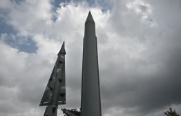 "Replicas of a North Korean Scud-B missile (R) and South Korea's Nike missile (L) are displayed at the Korean War Memorial in Seoul on August 16, 2019. - North Korea fired two unidentified projectiles into the sea on August 16, and launched a scathing attack on ""foolish"" calls for dialogue from South Korean President Moon Jae-in. (Photo by Jung Yeon-je / AFP)"