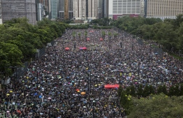Protesters gather for a rally in Victoria Park in Hong Kong on August 18, 2019, in the latest opposition to a planned extradition law that has since morphed into a wider call for democratic rights in the semi-autonomous city. - Hong Kong democracy activists gathered August 18 for a major rally to show the city's leaders their protest movement still attracts wide public support despite mounting violence and increasingly stark warnings from Beijing. (Photo by ISAAC LAWRENCE / AFP)