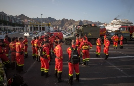 Members of the Spanish Army Emergency Military Unit prepare to travel by boat from Tenerife to the island of Gran Canaria to participate in the extinction of a new forest fire in the town of Valleseco on August 17, 2019. - Authorities in the Spanish island of Gran Canaria were evacuating a luxury hotel and tourist spot as a new forest fire broke out just days after another blaze raged in the same area. PHOTO: DESIREE MARTIN / AFP)