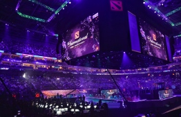 This general view shows the opening ceremony of the International Dota 2 Championships in Shanghai on August 20, 2019. - A record 33.5 million USD is up for grabs but professional eSports players like those competing in The International in Shanghai in mid August, pay a physical price with deteriorating eyesight, digestive problems and wrist and hand damage. (Photo by STR / AFP) /