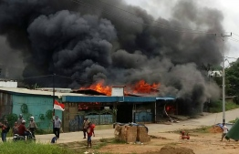 Several cities in Papua New Guinea were brought to a standstill, including Manokwari where businesses and the local parliament building were set ablaze by angry demonstrators. PHOTO: AFP