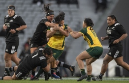 New Zealand's Liz Patu (centre L) and Michaela Leonard tackle Australia's Toka Natua (R) during the Rugby Test match between the Australia Wallaroos and New Zealand Blacks Ferns in Auckland on August 17, 2019.  PHOTO: GREG BOWKER / AFP