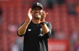 Liverpool's German manager Jurgen Klopp applauds supporters on the pitch after the English Premier League football match between Southampton and Liverpool at St Mary's Stadium in Southampton, southern England on August 17, 2019. - Liverpool won the game 2-1. (Photo by Glyn KIRK / AFP) / RESTRICTED TO EDITORIAL USE. No use with unauthorized audio, video, data, fixture lists, club/league logos or 'live' services. Online in-match use limited to 120 images. An additional 40 images may be used in extra time. No video emulation. Social media in-match use limited to 120 images. An additional 40 images may be used in extra time. No use in betting publications, games or single club/league/player publications. /