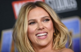 (FILES) In this file photo taken on July 20, 2019 US actress Scarlett Johansson arrives on stage for the Marvel panel in Hall H of the Convention Center during Comic Con in San Diego, California. - Superhero Black Widow is a woman at the top of her game, and so is the actress who plays her -- Scarlett Johansson is the world's highest paid actress for the second year in a row, according to Forbes's annual ranking published August 23, 2019. (Photo by VALERIE MACON / AFP)