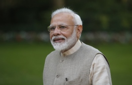 Indian Prime Minister Narendra Modi looks on in the garden of the French Prime Minister's residence in Paris on August 23, 2019, ahead of a meeting. (Photo by Michel Spingler / POOL / AFP)