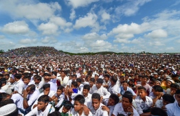 Rohingya refugees attend a ceremony organised to remember the second anniversary of a military crackdown that prompted a massive exodus of people from Myanmar to Bangladesh, at the Kutupalong refugee camp in Ukhia on August 25, 2019. Some 200,000 Rohingya rallied in a Bangladesh refugee camp on August 25 to mark two years since they fled a violent crackdown by Myanmar forces, just days after a second failed attempt to repatriate the refugees. PHOTO: MUNIR UZ ZAMAN / AFP