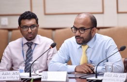 Finance Minister Ibrahim Ameer (R) speaks at the budget committee meeting regarding the government's proposal to extend the state budget, on August 25, 2019. PHOTO: NISHAN ALI / MIHAARU