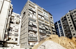 This picture taken on August 25, 2019 shows damage to a building housing a media centre of the Lebanese Shiite group Hezbollah in the south of the capital Beirut, after two drones came down in its vicinity earlier in the day. - Hezbollah said on August 25 that one of the drones was rigged with explosives and caused damage to its media centre, but denied shooting down any of them. The early morning incident came hours after Israel launched air strikes in neighbouring Syria, but Hezbollah officials could not confirm if the drones deployed in Lebanon were Israeli. Another Hezbollah source told AFP the Iran-backed Shiite militant group -- a major political player in Lebanon with representatives in parliament and the government -- has not determined if the drones were Israeli. (Photo by ANWAR AMRO / AFP)