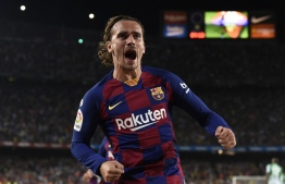 Barcelona's French forward Antoine Griezmann celebrates after scoring a second goal during the Spanish League football match between Barcelona and Real Betis at the Camp Nou stadium in Barcelona on August 25, 2019. (Photo by Josep LAGO / AFP)