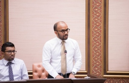 Minister of Finance Ibrahim Ameer speaking at the parliament. PHOTO: PARLIAMENT SECRETARIAT