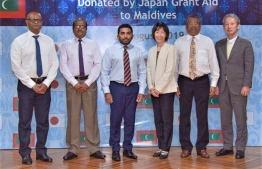 Minister of Health Abdulla Ameen (C-L) and Japanese Ambassador to Maldives Keiko Yanai (C-R) alongside senior officials of the two governments. PHOTO: MINISTRY OF HEALTH