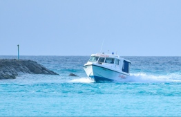 A speed launch traveling through the channel to enter an island's lagoon. PHOTO: HUSSAIN WAHEED/ MIIHAARU