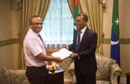 President of Presidential Commission submits report on the investigation into the disappearance of journalist Ahmed Rilwan to Parliament Speaker Mohamed Nasheed. PHOTO: PARLIAMENT