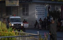 An ambulance is pictured outside Wazir Akbar Khan hospital as people wait after a massive explosion the night before in Kabul on September 3, 2019. - A massive explosion rocked central Kabul late on September 2, killing at least five people in a Taliban-claimed attack near an international complex while the US special envoy leading talks with the insurgents visited the Afghan capital. (Photo by WAKIL KOHSAR / AFP)