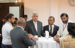 Sri Lanka Prime Minister Ranil Wickremesinghe (C) and Speaker of Parliament Mohamed Nasheed (R-3) after the PM addressed the Maldivian parliament. PHOTO/MAJILIS