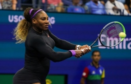 Serena Williams of the US returns the ball against Qiang Wang of China in their Women's Singles Quarter-finals tennis match during the 2019 US Open at the USTA Billie Jean King National Tennis Center in New York on September 3, 2019. (Photo by DOMINICK REUTER / AFP)