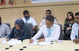 Director General of the Planning Ministry Shana Faarooq and MWSC Managing Director Adam Azim. signing the agreement. PHOTO: MINISTRY OF NATIONAL PLANNING AND INFRASTRUCTURE