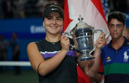 Bianca Andreescu of Canada holds her trophy after she won against Serena Williams of the US after the Women's Singles Finals match at the 2019 US Open at the USTA Billie Jean King National Tennis Center in New York on September 7, 2019. (Photo by TIMOTHY A. CLARY / AFP)