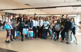 The group of 45 Ukranian social media influencers after they arrived in  Velana International Airport (VIA). PHOTO: MALDIVES MARKETING AND PUBLIC RELATIONS (MMPRC)