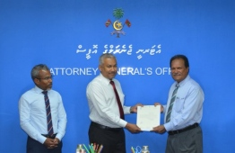 Ahmed Shiyau being handed the letter of appointment at a ceremony held at the Attorney General's Office. PHOTO: CIVIL SERVICE COMMISSION (CSC)