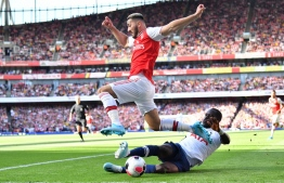 Arsenal's German-born Bosnian defender Sead Kolasinac is tackled by Tottenham Hotspur's French midfielder Moussa Sissoko during the English Premier League football match between Arsenal and Tottenham Hotspur at the Emirates Stadium in London on September 1, 2019. (Photo by Ben STANSALL / AFP) / RESTRICTED TO EDITORIAL USE. No use with unauthorized audio, video, data, fixture lists, club/league logos or 'live' services. Online in-match use limited to 120 images. An additional 40 images may be used in extra time. No video emulation. Social media in-match use limited to 120 images. An additional 40 images may be used in extra time. No use in betting publications, games or single club/league/player publications. /
