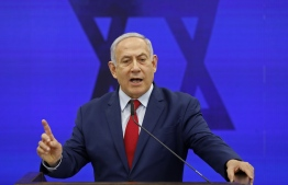 Israeli Prime Minister Benjamin Netanyahu gives a statement in Ramat Gan, near the Israeli coastal city of Tel Aviv, on September 10, 2019. - Israeli Prime Minister Benjamin Netanyahu issued a deeply controversial pledge on September 10 to annex the Jordan Valley in the occupied West Bank if re-elected in September 17 polls. He also reiterated his intention to annex Israeli settlements throughout the West Bank if re-elected, though in coordination with US President Donald Trump, whose long-awaited peace plan is expected to be unveiled sometime after the vote. (Photo by Menahem KAHANA / AFP)