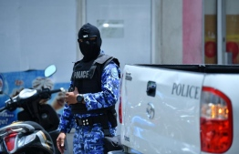 A police officer during the special operations conducted to aid the investigations of presidential Commission on Investigation of Murders and Enforced Disappearances. PHOTO: HUSSAIN WAHEED/ MIHAARU