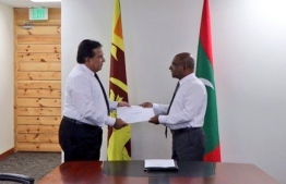 Foreign Minister Abdulla Shahid issues document of the new land area for the embassy of Sri Lanka. PHOTO/FOREIGN MINISTRY