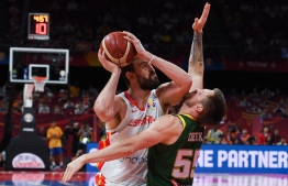 Spain's Marc Gasol (L) fights for the ball with Australia's Patty Mills during the Basketball World Cup semi-final game between Australia and Spain in Beijing on September 13, 2019. (Photo by Greg BAKER / AFP)