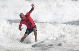 Kelly Slater of the US rides a wave in men's repechage final during the ISA World Surfing Games at Kisakihama Beach in Miyazaki on September 15, 2019. (Photo by Behrouz MEHRI / AFP)
