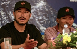 (FILES) In this file photo taken on May 28, 2019 mountaineer Nirmal Purja speaks as Nepali mountaineer Mingma David Sherpa (R) looks on during a press conference in Kathmandu. - The current record for reaching the top of the world's 14 tallest peaks is almost eight years. Nepali climber and former British special forces soldier Nirmal Purja's target is seven months. (Photo by PRAKASH MATHEMA / AFP)