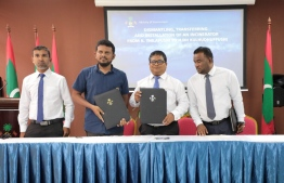 Minister of Environment Dr Hassan Rasheed Hussain at the ceremony held at the ministry to award two companies with establishing incinerators on three islands. PHOTO: ENVIRONMENT MINISTRY