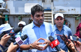 Managing Director of State Trading Orgnisation (STO) speaking to the press on a trip to Felivaru where the MIFCO fish factory is located. PHOTO: HUSSAIN WAHEED/ MIHAARU