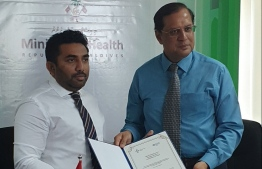 Minister of Health Abdulla Ameen and WHO Maldives' Representative Dr Arvind Mathur. PHOTO: MINISTRY OF HEALTH / TWITTER