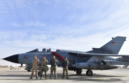 (FILES) In this file photo taken on January 13, 2018 German air force pilots stand in front of a Tornado reconnaissance aircraft  at the Al Azraq air base in Jordan as the German Defence visited the German contingent there. - Germany on September 18, 2019 extended by one year its military contribution to the multinational coalition against the Islamic State group but decided to end its Tornado reconnaissance flights in six months. (Photo by John MACDOUGALL / AFP)