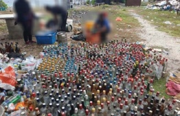 Maldives Police Service disposed of large quantities of alcohol at Dhoonidhoo, Kaafu Atoll, that were confiscated over 240 cases between 2008- 2014. PHOTO: POLICE