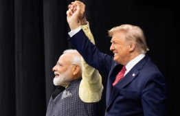 "US President Donald Trump and Indian Prime Minister Narendra Modi attend ""Howdy, Modi!"" at NRG Stadium in Houston, Texas, September 22, 2019. - Tens of thousands of Indian-Americans converged on Houston on Sunday for an unusual joint rally by Donald Trump and Narendra Modi, a visible symbol of the bond between the nationalist-minded leaders. With many in the crowd decked out in formal Indian attire or the signature saffron of Modi's Bharatiya Janata Party, the event kicked off in a football stadium with a Sikh blessing, boisterous bhangra dancing and, in a nod to local customs, cheerleaders in cowboy hats. (Photo by SAUL LOEB / AFP)"