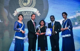 Resort Manager of Summer Island Maldives Mari Shareef (C) receiving one of the awards at the banquet. PHOTO: SOUTH ASIAN TRAVEL AWARDS