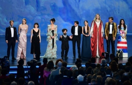 """The cast of """"Game of Thrones"""" speaks onstage during the 71st Emmy Awards at the Microsoft Theatre in Los Angeles on September 22, 2019. (Photo by Frederic J. BROWN / AFP)"""